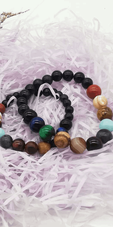This space witch bracelet will send your spirituality into the galaxy! Wear the planets on your wrist. Perfect gift for eclectic witches, astronomers, people into astrology, and anyone that loves the galaxy. #space #spacewitch #witchcraft #witch #pagan #wicca #astrology #astronomy #galaxy #universe