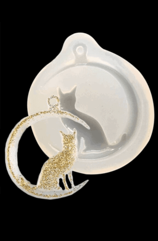 A cat and crescent moon pendant and its mold