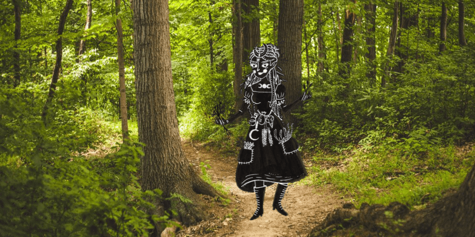 An illustrated witch in a bright green forest
