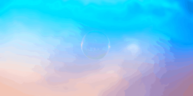 A single bubble against a pink and blue sky