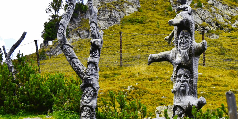 Pagan sculptures in dead trees of spirits or deities