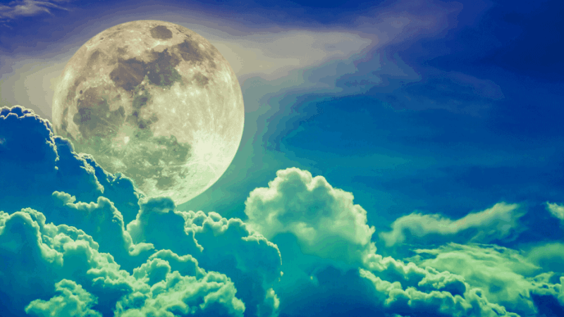 Decorative image of the moon behind clouds
