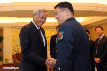 People's Liberation Army (PLA), meets with Ng Eng Hen, Singapore's Defense Minister, on the sidelines of the 14th Shangri-La Dialogue in Singapore