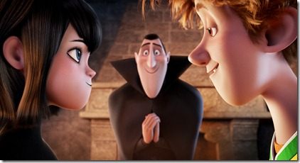 Dracula (Adam Sandler) looks on nervously as his daughter Mavis (Selena Gomez) and the human boy Jonathan (Andy Samberg) share an intimate moment in HOTEL TRANSYLVANIA, an animated comedy from Sony Pictures Animation.
