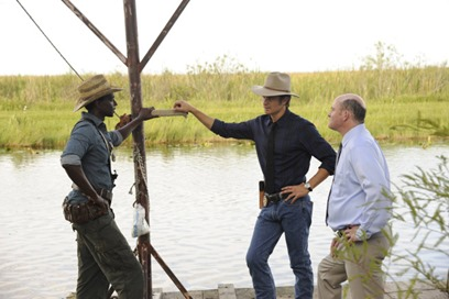JUSTIFIED -- A Murder of Crowes -- Episode 501 (Airs Tuesday, January 7, 10:00 pm e/p) -- Pictured: (L-R) Edi Gathegi as Jean Baptiste, Timothy Olyphant as Deputy U.S. Marshal Raylan Givens, David Koechner as Deputy Marshall Gregg Sutter -- CR: Guy D'Alama/FX