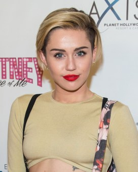 LAS VEGAS, NV - December 27 : Miley Cyrus pictured at Britney Spears 'Piece of me' premiere at Planet Hollywood Resort on December 27, 2013 in Las Vegas, NV. Credit:  RTNRDKabik /MediaPunch Inc.