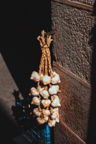 Photo of a braid of garlic, as a way to store and preserve fruit and vegetables
