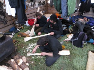 The men are carving wooden snow shovels – like the one we used while setting the fish net.