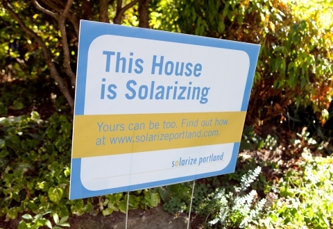 """A sign that says """"This House is Solarizing"""""""