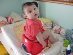 Our daughter, Anjali, at 4 months on the potty