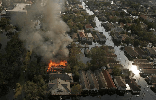 :House burns in Katrina flood.png