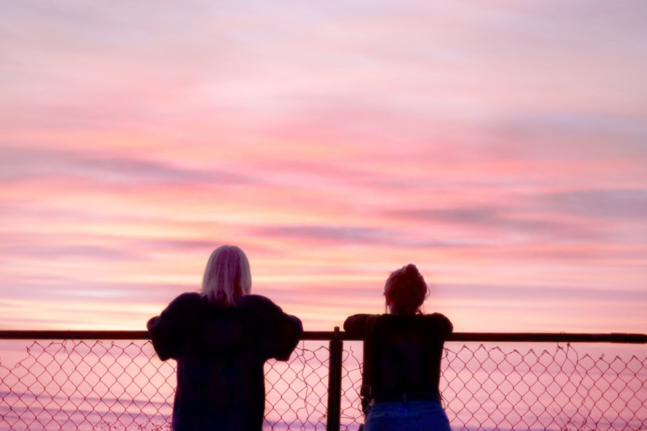 best friends watching sunset