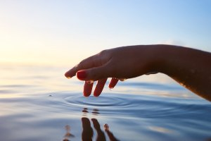 A human hand touching water