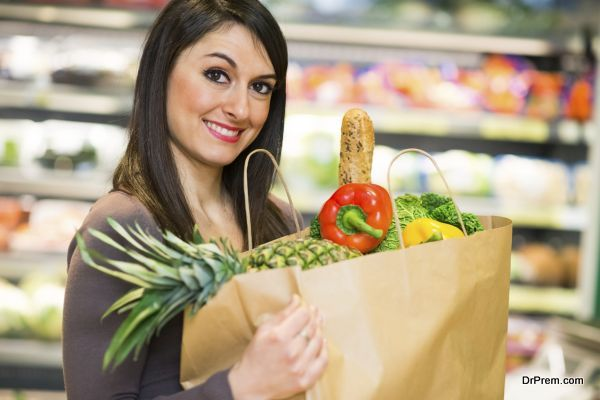 Smiling woman shopping in a supermarket