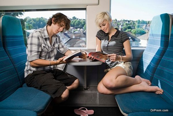 Young people reading in train