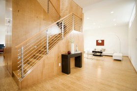 Using bamboo for the main floor and continuing on with bamboo up the stair case give a clean, contemporary look.