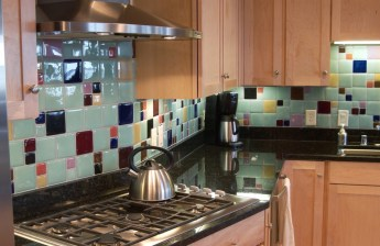 "Modern mix of 4"" and 2"" glass tile next to Maple Cabinets and Granite Countertops"