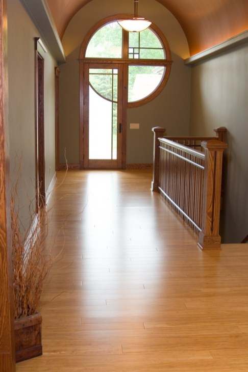 Natural Fibrestrand bamboo works is synergistic with Oak finishes in a Craftsman style home.