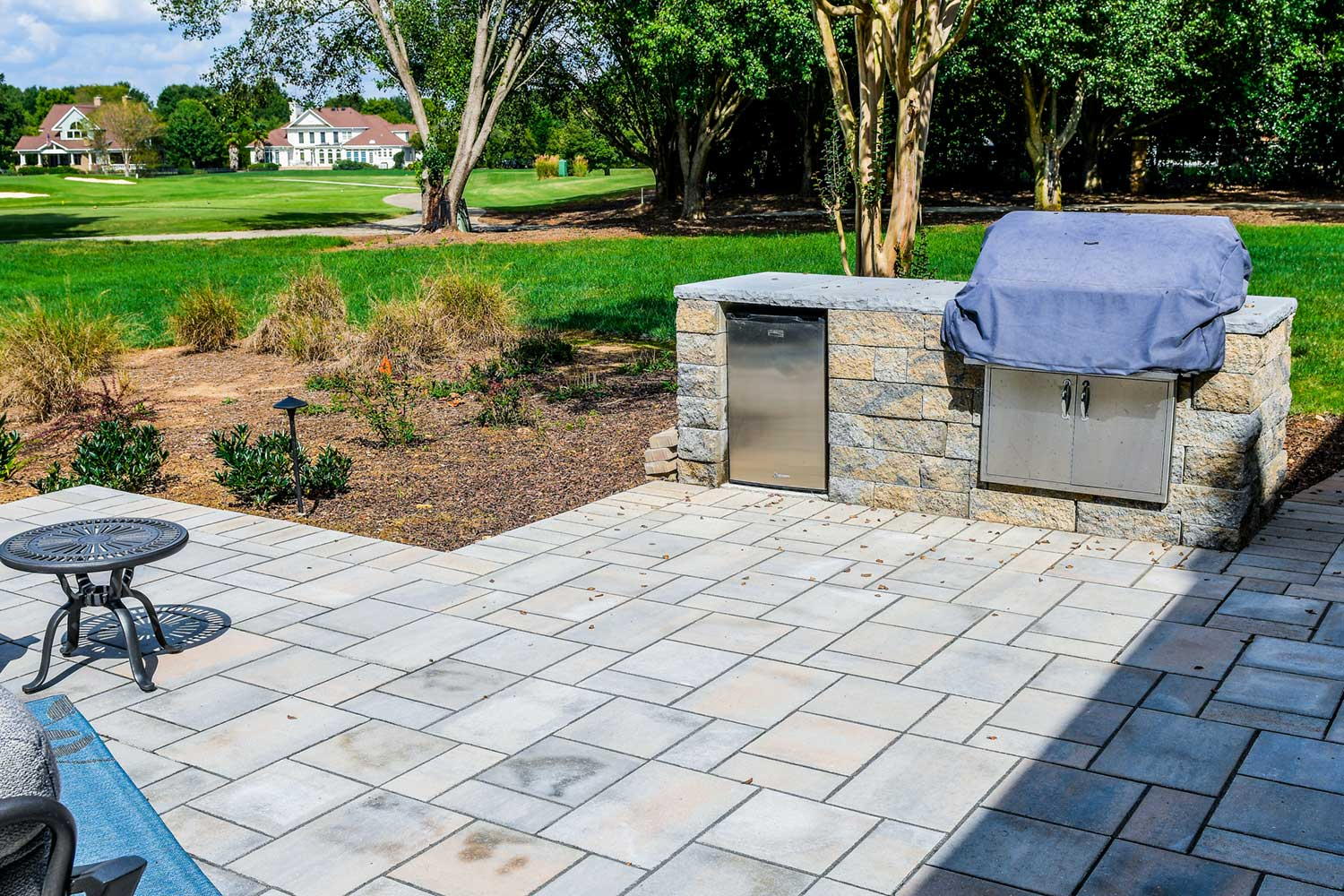 outdoor patio with grill ecogreen