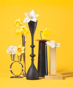 Candlestick as Bud Vase Cut stems short and add water to keep blooms upright for a night. (Alas, beauty is fleeting.)