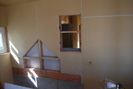 Another window in wall to allow natural light into back room