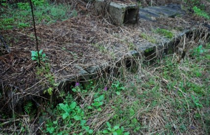 Discarded U-shaped concrete blocks to be used for drainage