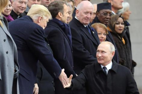 Russian President Vladimir Putin shakes hands with U.S. President Donald Trump as he arrives to attend a commemoration ceremony for Armistice Day, 100 years after the end of the First World War at the Arc de Triomphe, in Paris