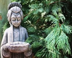 ... Image: Concrete Garden Statues Anchor The Landscape.