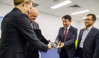 EcoMag Executive Chairman Tony CRIMMINS and Abundant Natural Health CEO Shanan BIRKIN with a gift of Abundant Natural Health products containing EcoMag magnesium to Jeong Wook SEO, Senior Vice President, Daejoo-KC Group, with Dr Dae Woong KIM, Director of Research, Daejoo-KC Group.