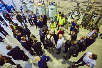 EcoMag's Chief Technology Officer, Professor Tam Tran shows investors a sample of EcoMag's hydrated magnesium carbonate.