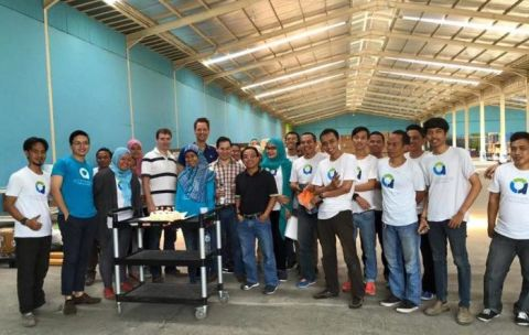 A multi-national and culture team of aCommerce in a warehouse