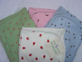 SageCreekNaturals blankets, white, green, pink and blue