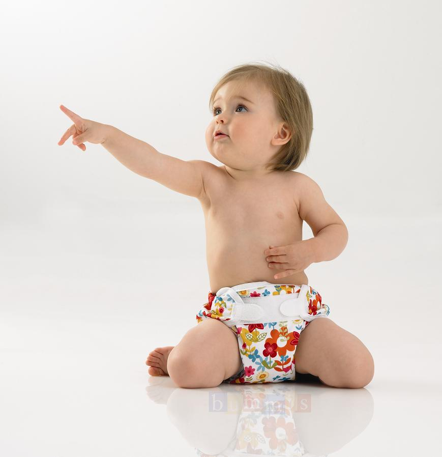 infant dressed in colourful diaper wrap