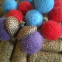 purple double acorn ornament with blue and red felted balls