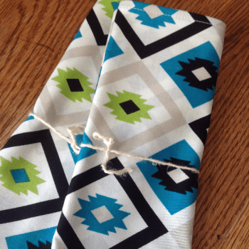Navajo pattern in blue, green and black on white cloth napkin