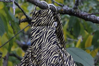 zebra striped fabric midwifery weigh sling, black with gilded stripes