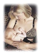 caucasian woman in leapard pattern nursing bra, nursing baby.