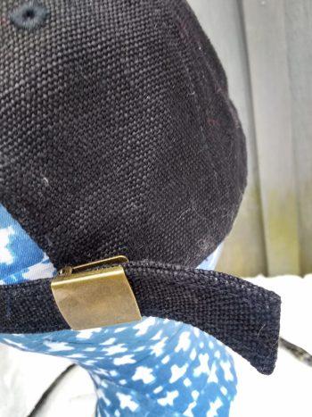 back clasp detail of black hemp ball cap