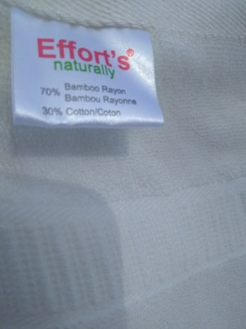 Efforts label on white bamboo towel, detail of woven accent