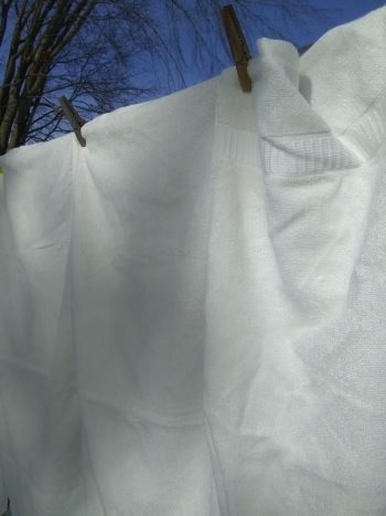 white bamboo towels hung on clothes line on sunny winter day