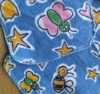blue flannel decorated with stars, bugs and hearts