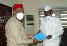Chairman RMAFC Engr Elias Mbam receives ASVI reports from Yushau A. Shuaib of Economic Confidential