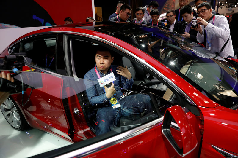 Tesla promotes lower priced China-made Model 3 in sales ...