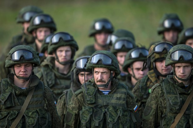 Russian troops stand after a training exercise in the village of Nikinci