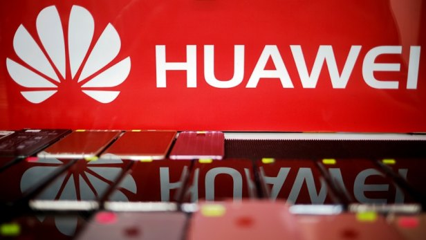 FILE PHOTO: The logo of Huawei is pictured at a mobile phone shop in Singapore