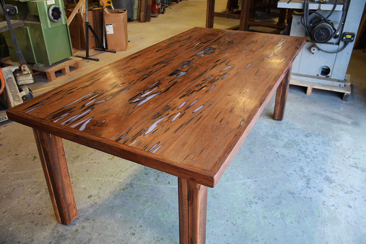 This is the Custom Table Top by Billy with the legs attached. Eco Relics Wood Shop Creates Another Stunning Table
