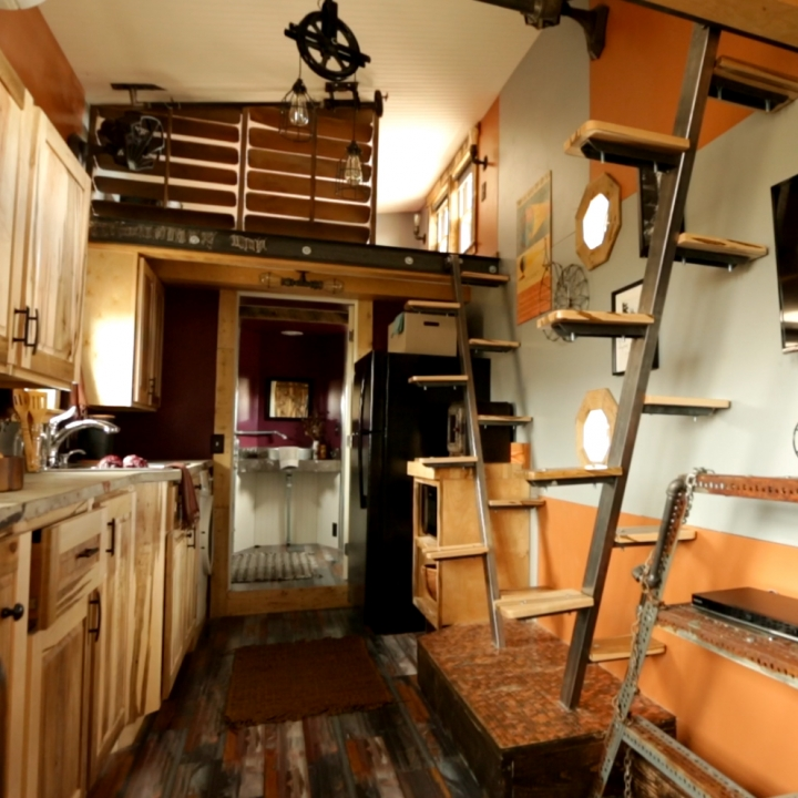 Innovative storage ideas abound in this Tiny House Interior.