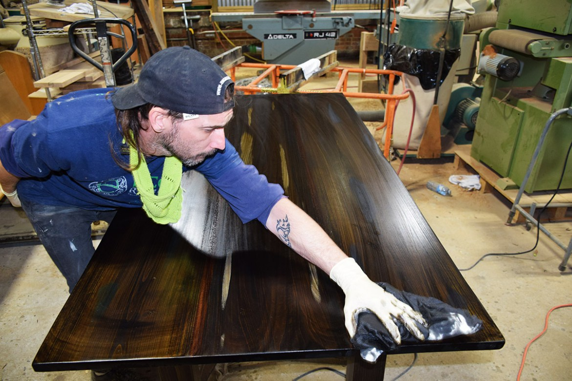 Custom Sapele and Cypress table getting stain coat