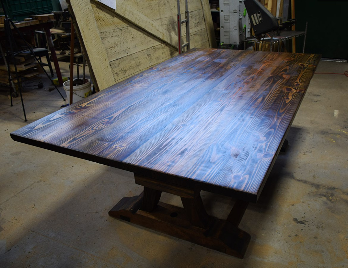 The table is finished and assembled in the shop before delivery.