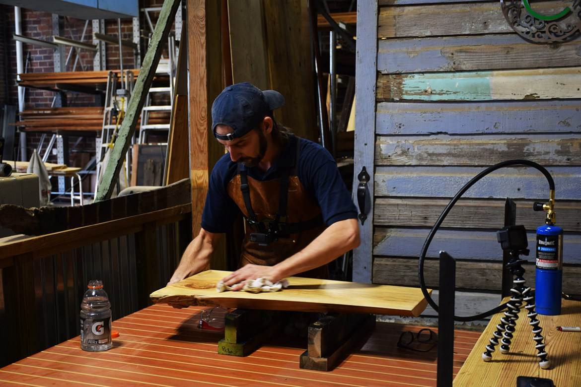 Billy will sometimes prep the wood to be flamed with a damp cloth.